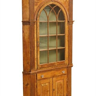 An American 18th Century Pine Corner Cabinet.