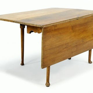 An Early 20th Century Drop Leaf Table.