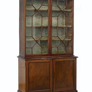 An English Georgian Mahogany Bookcase Cabinet.
