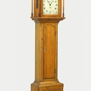 An Early 19th Century American Pine Tall Case Clock.