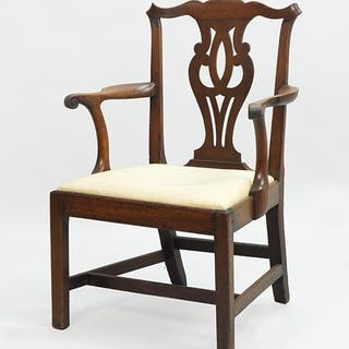 An American Chippendale Carved Mahogany Open Armchair.