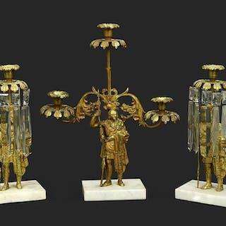 A Three-Piece Gilt Brass Figural Girandole Set.