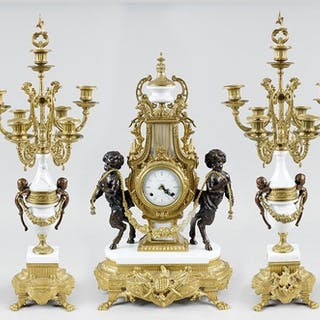 A German Clock & Garniture Suite.