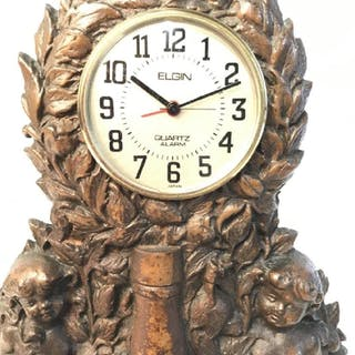 Cherub Flanked Metal Clock