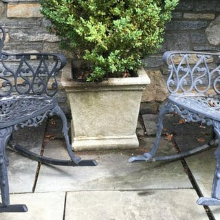 Pair Iron Outdoor Rocking Chairs W Openwork Design