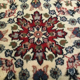 Oriental Wool Carpet With Floral And Vine Design