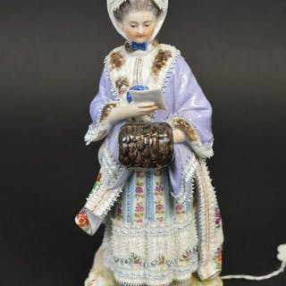 Meissen Porcelain Figure woman in gown reading.