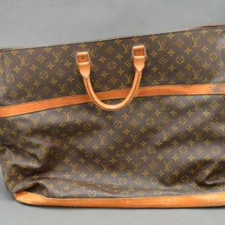 "Vintage Louis Vuitton travel bag, 23""h x 28""w (worn &"
