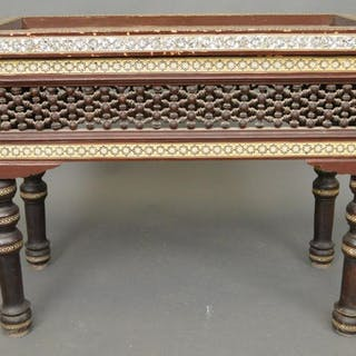 Diminutive highly decorated occasional table with