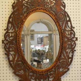 Carved Mahogany Figural Mirror
