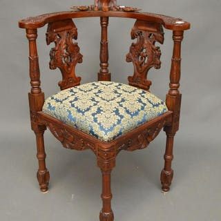 Heavily carved corner chair, upholstery matches above