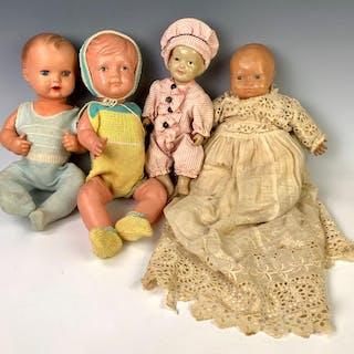 Lof of Four Dolls