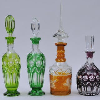 Four colored cut to clear glass decanters. (1) Dark