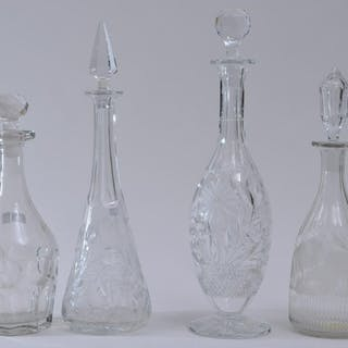 Four clear glass decanters. Three cut glass decanters.