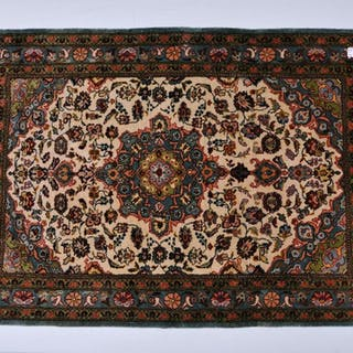 Small silk Oriental carpet. White medallion with floral
