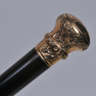 Wood and gold filled head walking stick. Top engraved