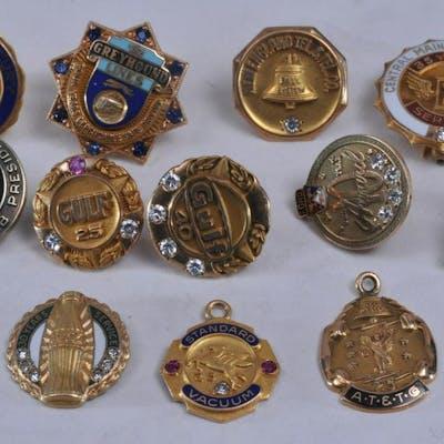 Lot of twelve 10 karat gold enameled insignias.  26.4