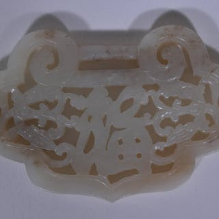 Jade pendant. China. 19th C. Grey-white stone. Carved