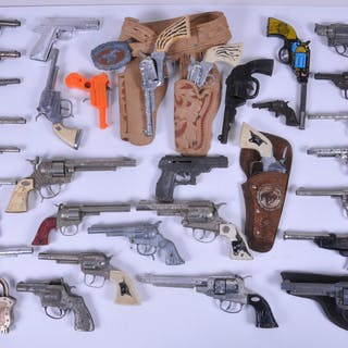 Box lot of toy cap guns with 33 toy guns and one