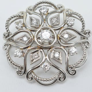18 kt white gold and diamond mounted pin. 13 various