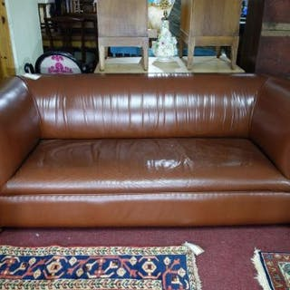 An Edwardian Brown Leather Chesterfield Sofa Raised On Castors H