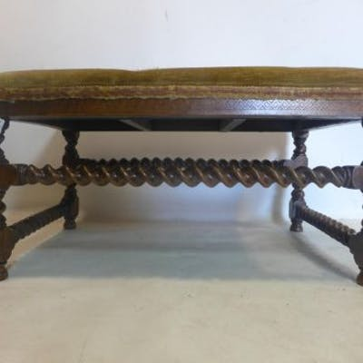 A large 19th century oak stool, with tapestry upholstery, raised on