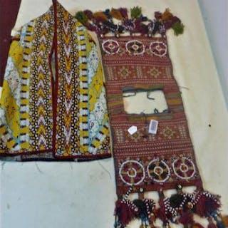 A Turkoman Yomud ceremonial saddle bag, together with a Turkoman silk