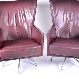 A pair of mid century design leather swivel armchairs probably Italian