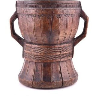 A large antique double handled vessel possibly African, the body decorated