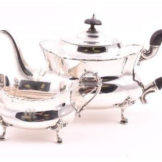 An Edwardian two-piece silver part tea set Birmingham 1912, by Williams