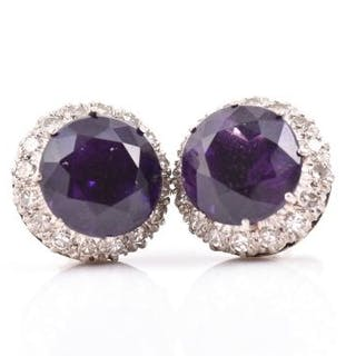 A pair of diamond and amethyst cluster earrings of rounded form, set