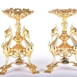 A pair of 20th century gilt metal comport stands modelled as stylised