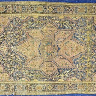 A Persian Heriz rug designed with central geometric medallion with