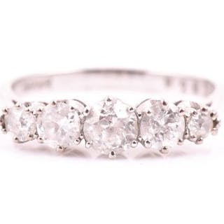 An 18ct white gold and diamond ring set with five graduated old round-cut