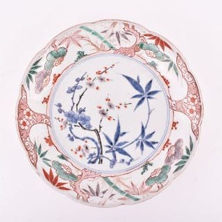 A Chinese Qing dynasty famille verte porcelain plate with underglazed