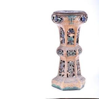 A Chinese incense burner and stand possibly Tang the tall terracotta