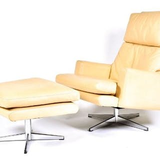 A 1970s mushroom leather upholstered swivel armchair and conforming