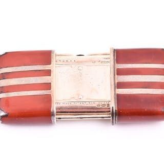 A 1920s Movado Ermeto silver gilt and red enamel purse watch the white