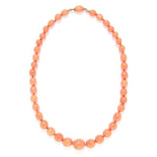 CORAL BEAD NECKLACE comprising of a single strand of coral beads ranging