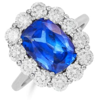 TANZANITE AND DIAMOND CLUSTER RING in 18ct white gold, set with an