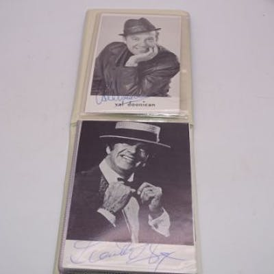 AUTOGRAPHS: A small photograph album containing si