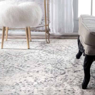 Ivory Rug Bring antiqued inspiration and a patterned foundation to