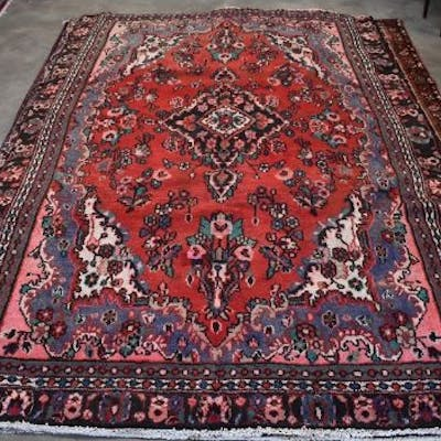 A Persian Hamadan small carpet, stylised floral design on red ground