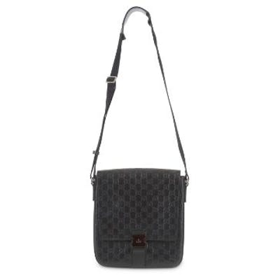 f6a624c77 Gucci Black Signature Messenger Bag, heat stamped Guccissima leather ...