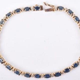 A sapphire and diamond eternity bracelet