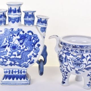 A 19th century Chinese blue and white ceramic tripod censor with partial