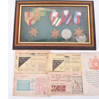 A framed group of five WWII medals including Africa Star, Italy Star