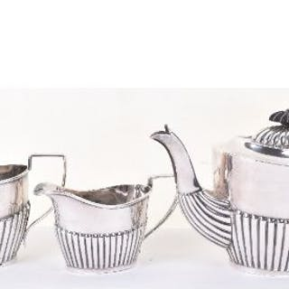 An early 20th century silver three piece tea set, William J. Holmes