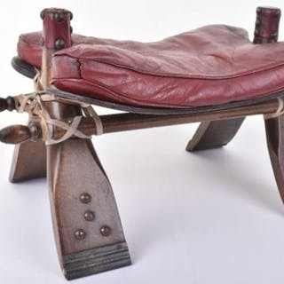 An early 20th century camel seat, leather seat and stud work