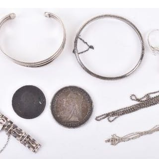 Two silver bangles, a silver bracelet with padlock locket, two silver